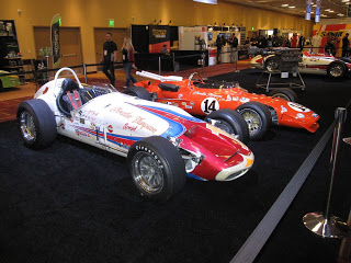 Several of A.J. Foyt's Indy Cars on display at the PRI Show.