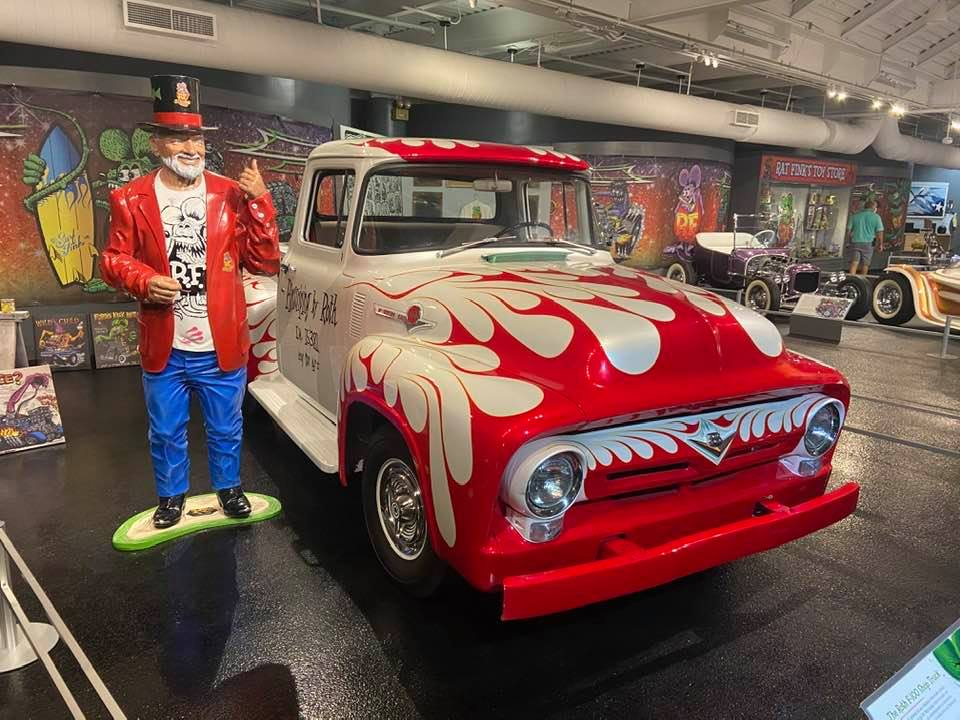 A statue of Ed Roth next to his Ford shop truck.